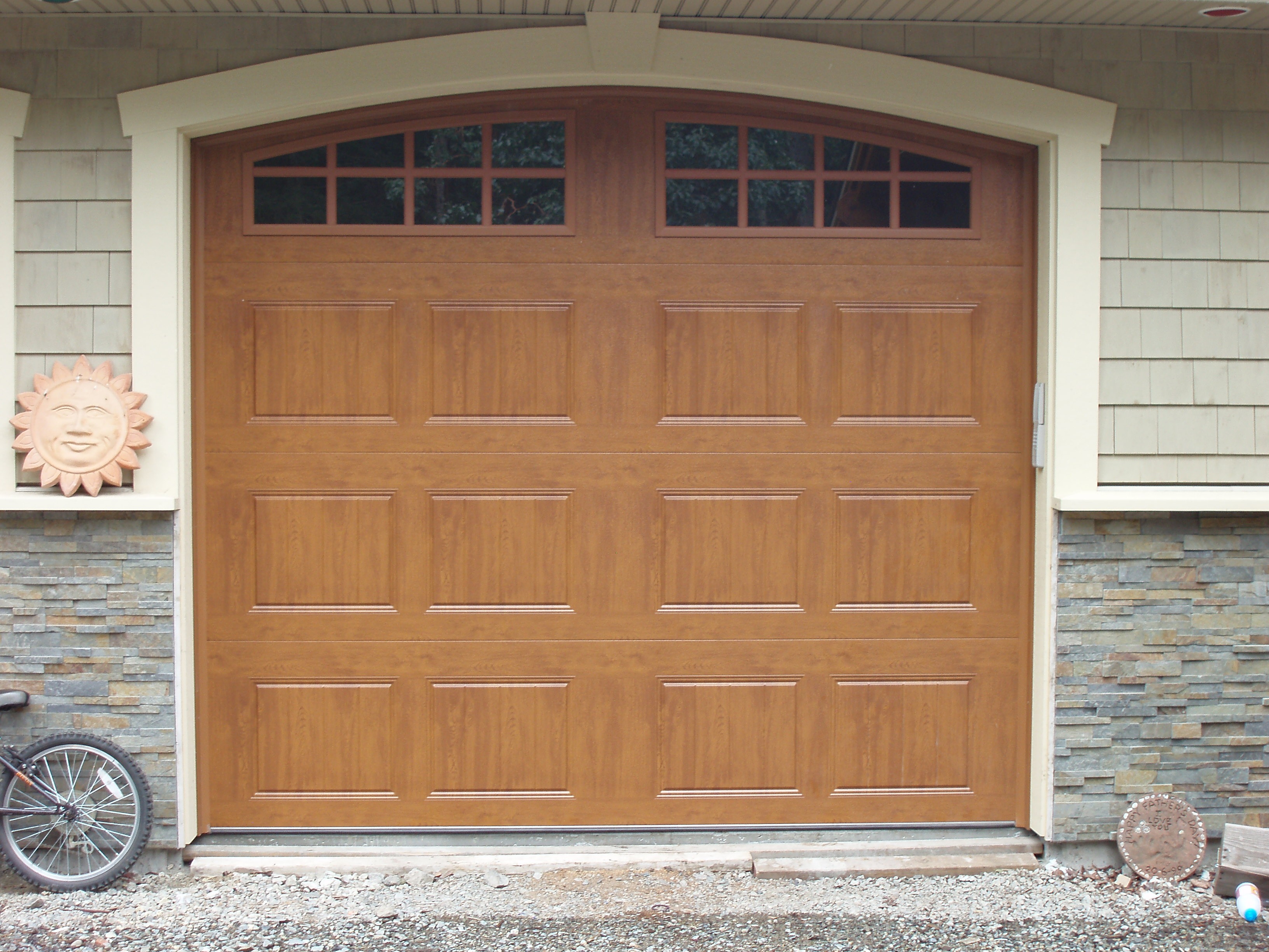 2448 #8D633E GD05 Clopay Gallery Series Door Short Panel With Long Panel Arch 1  picture/photo Gallery Garage Doors 35893264