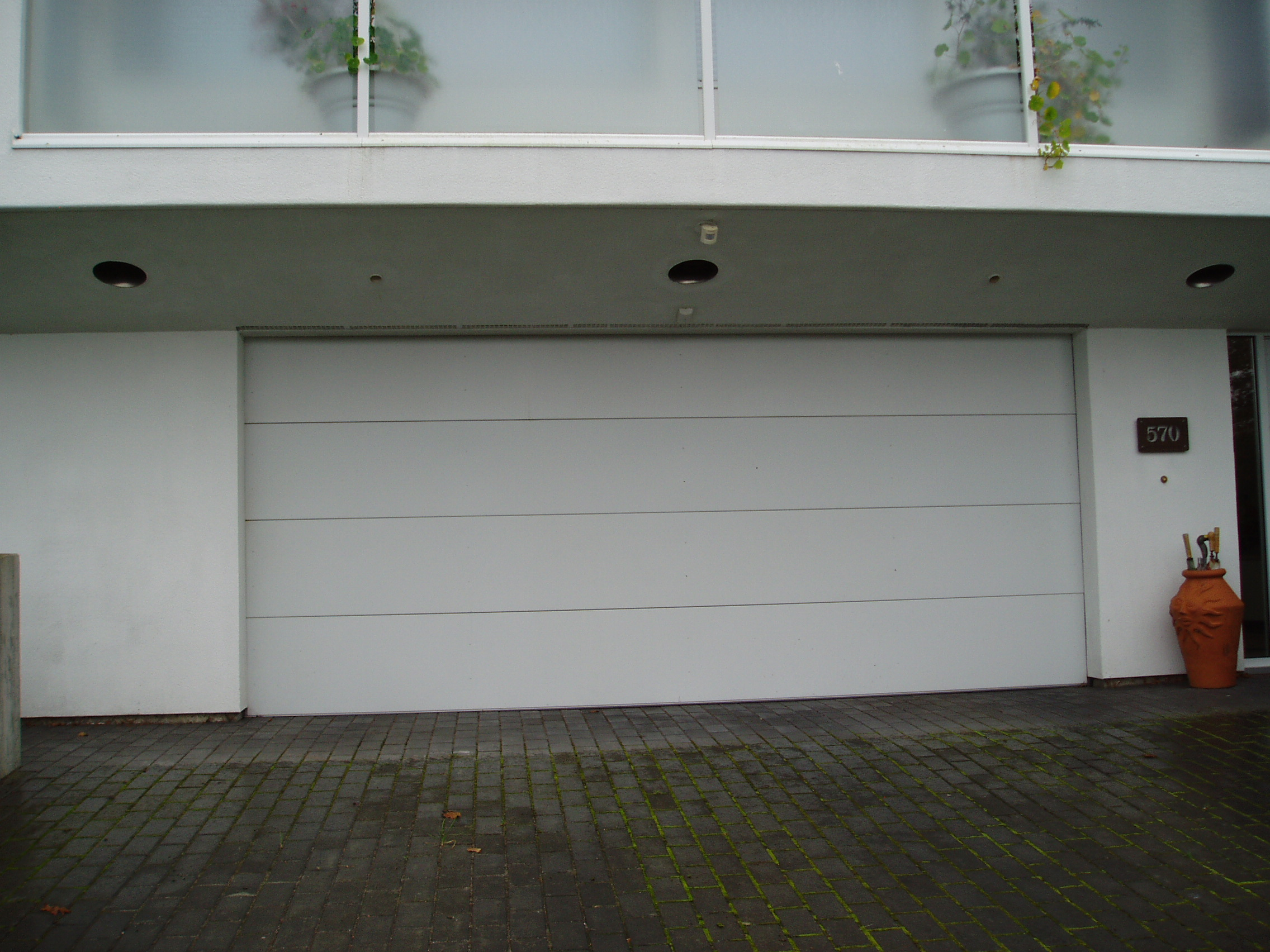 1704 #633C28 PC03 Clopay Premium Series Flush Style Solid/No Glass wallpaper Clopay Steel Garage Doors 37752272