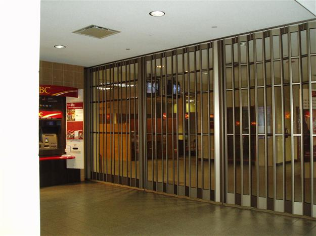 16 Sliding mall security grille