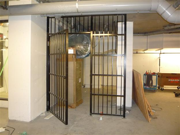 FS 15 - Security enclosure in parkade with swinging pedestrian gate