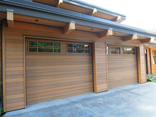 Wood flush insulated with custom cedar overlay and custom glass inserts