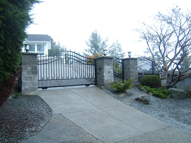 SG04 Custom Arched Sliding Aluminum Gate with Matching Infill Fencing and Pedestrian Gate