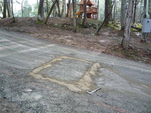 GC 24 In ground preformed exit loop laid in sand prior to pouring of asphalt driveway