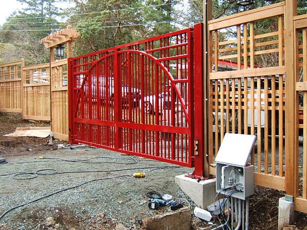 GM 10 Gates mounted on 6x6 steel posts with base plates showing footing detail and conduit into control box