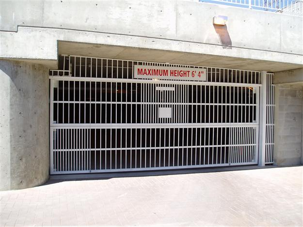 PD01 Two Piece Aluminum Parkade Gate with Matching Side Infill and Tapered Top Fascia