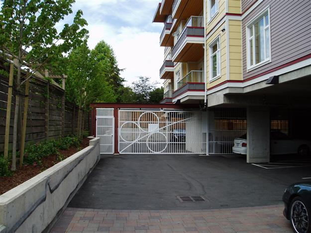 PD03 Sliding one piece alumimum parkade gate with pedestrian gate and security infill