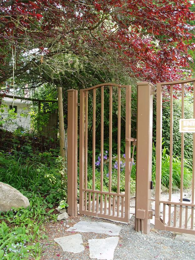 PG 02 Garden gate style ped gate to match double swing gate mounted on steel posts