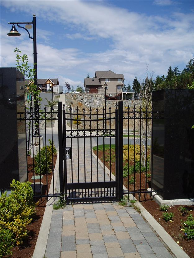 PG 07 Locking ped gate to match double swing gate mounted on aluminum posts for gated community