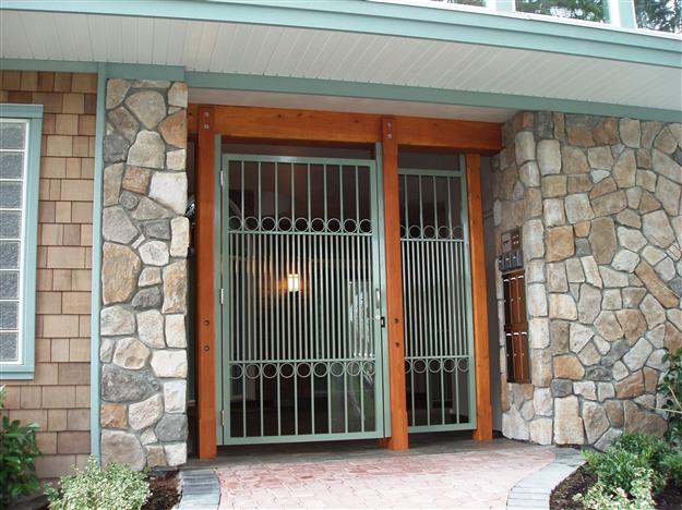 PG 09 Custom commercial ped gate with lexan added for security with custom matching infill