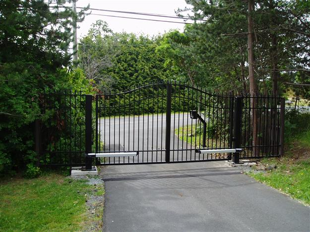 SWG 09 Aluminum gate style 2 variation mounted on concrete pads with steel posts matching fencing
