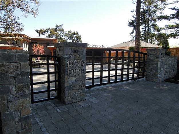 Sliding custom aluminum gate with matching pedestrian gate