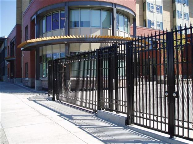 SG 01 Commercial sliding gate with ground track and matching pedestrian gate