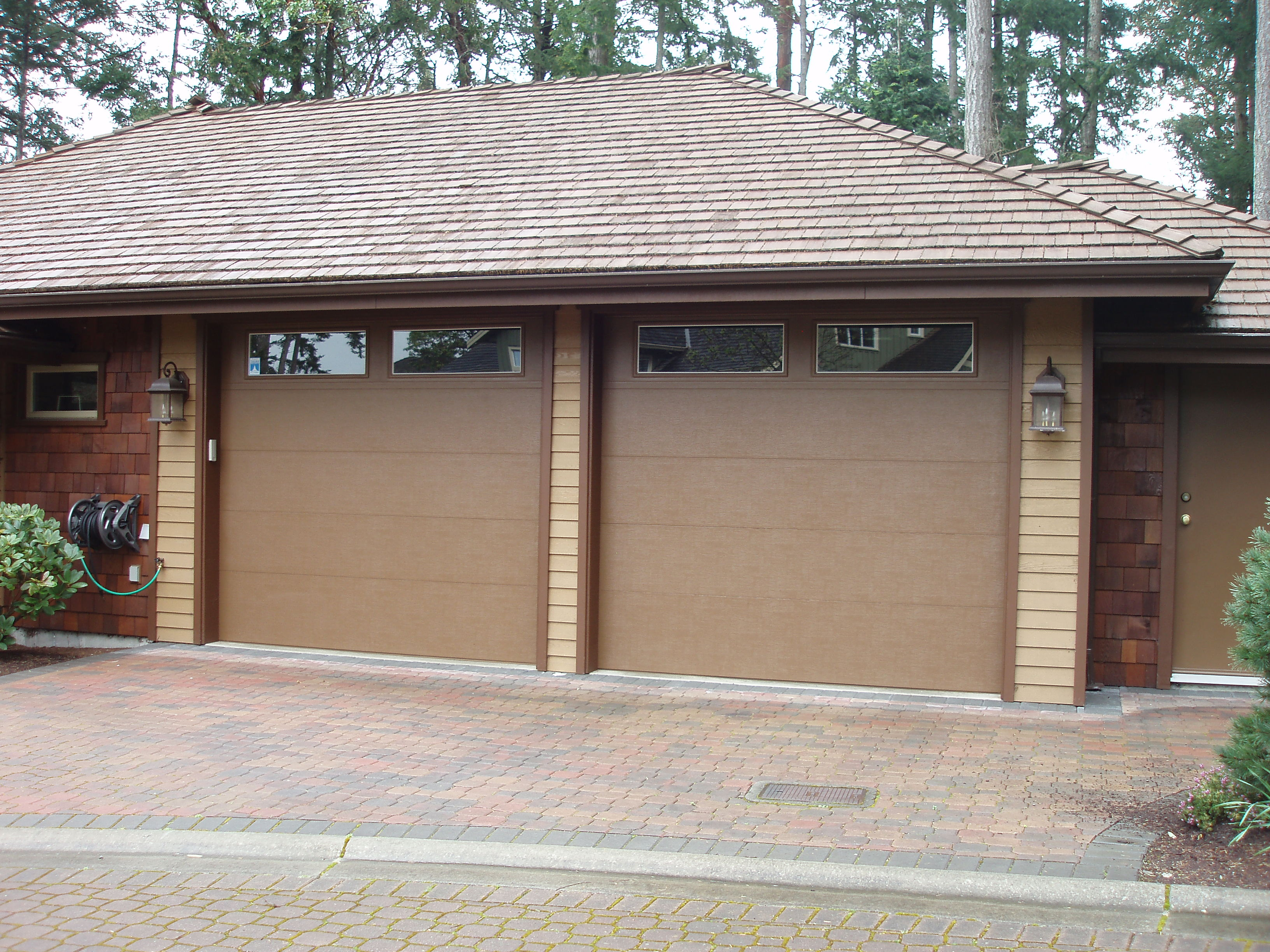 airport steel doors garage polyurethane door commercial insulated clopay spokane reviews