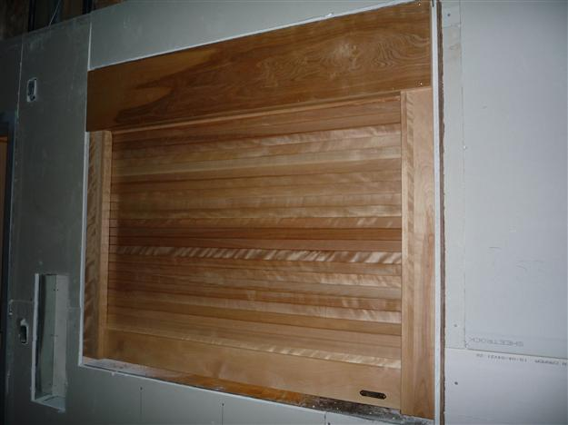 SP23 - Woodfold wood rolling counter shutter & Security Roll Shutters - Harbour Door pezcame.com