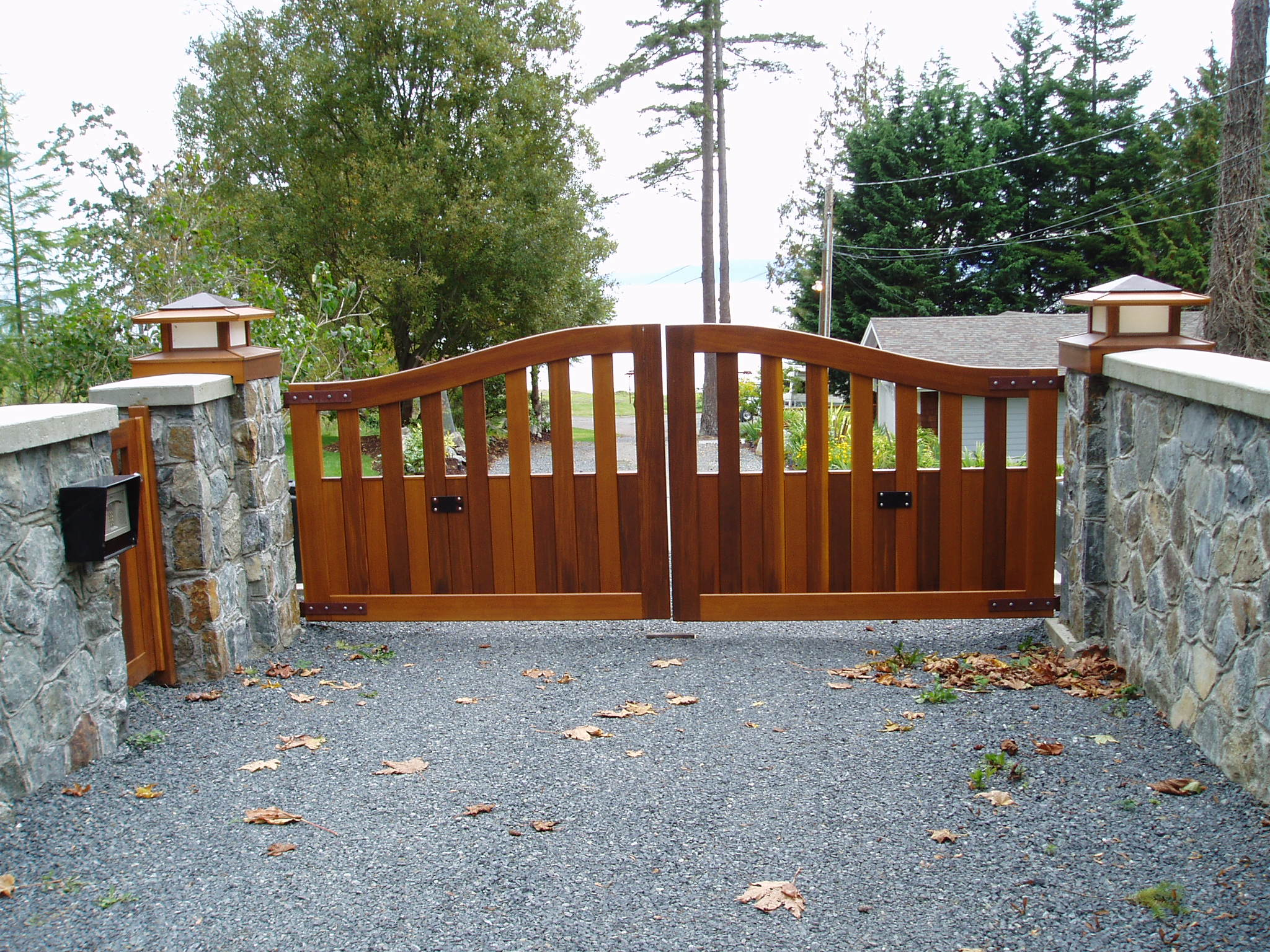 Swing gates articulating arms harbour door for Wooden driveway gates designs