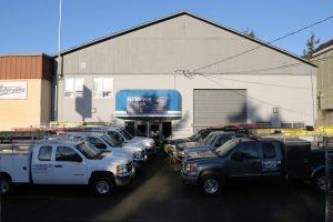 Truck fleet in front of warehouse